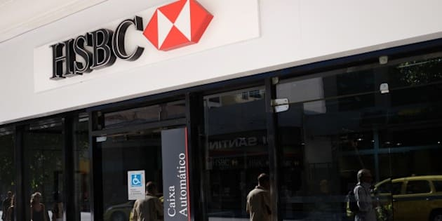 View of the facade of a HSBC bank cash dispenser, following the announcement of the bank to close HSBC Brazil, at Cinelendia square, downtown Rio de Janeiro on June 9, 2015. Scandal-hit bank HSBC said Tuesday it would cut its global headcount by up to 50,000 as part of a restructuring that entails its withdrawal from Brazil and Turkey, while it also mulls abandoning London as its HQ.   AFP PHOTO / CHRISTOPHE SIMON        (Photo credit should read CHRISTOPHE SIMON/AFP/Getty Images)