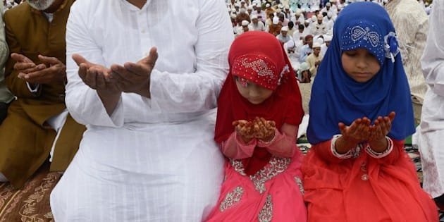 Indian Muslim devotees offer Eid prayers during the start of the Eid al-Fitr festival at the Quli Qutubshahi Eidgah in Hyderabad on July 29, 2014. Muslims around the world are celebrating Eid al-Fitr marking the end of the holy month of Ramadan during which followers are required to abstain from food, drink and sex from dawn to dusk. AFP PHOTO/NOAH SEELAM        (Photo credit should read NOAH SEELAM/AFP/Getty Images)
