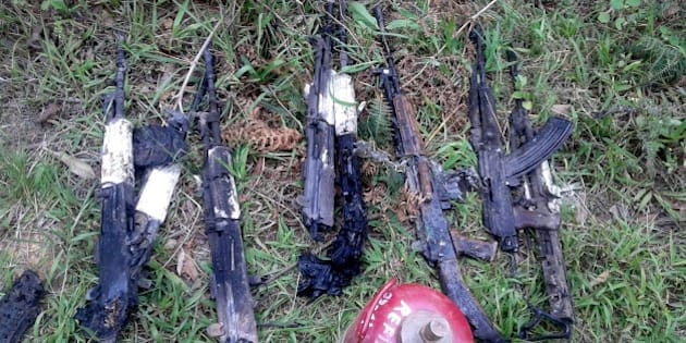In this photograph taken on June 4, 2015, weapons of the Indian army personel who were killed by militants lie at the scene of an attack on a military convoy in a remote area of Chandel district, about 120 kilometres (75 miles) southwest of northeastern Manipur's state capital Imphal.  Heavily armed rebels in India's restive northeast killed at least 20 troops on June 4, police said, in one of the area's worst such attacks in years.  AFP PHOTO        (Photo credit should read STR/AFP/Getty Images)