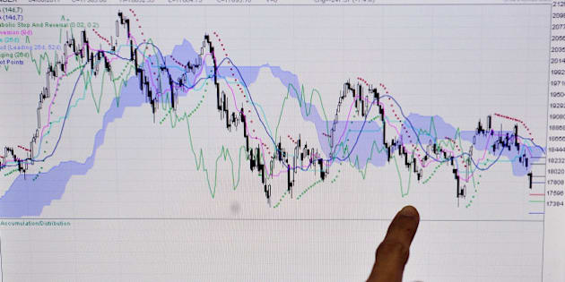 An Indian stockbroker refers to a graph showing the movement of the SENSEX in the year 2011 as he monitors share prices during intraday trade at a brokerage firm in Mumbai on August 5, 2011. Indian shares plunged by nearly four percent to its lowest point in over a year, triggered by US economic worries and the European debt crisis which have spooked world markets. The benchmark 30-share Sensex index on the Bombay Stock Exchange fell as much as 3.96 percent or 702.27 points to a day's low of 16,990.91. The last time the Sensex was below 17,000 was in June last year.  AFP PHOTO/Indranil MUKHERJEE (Photo credit should read INDRANIL MUKHERJEE/AFP/Getty Images)