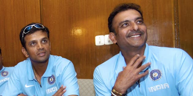 Dhaka, BANGLADESH: India's cricket captain Rahul Dravid (L) looks on as team manager Ravi shastri talks with journalists upon the team's arrival at the Zia International airport in Dhaka, 07 May 2007.  India cricket team will play three One Day International (ODI) matches and two Test matches with the host team starting 10 May.        AFP PHOTO/Farjana K. GODHULY (Photo credit should read FARJANA K. GODHULY/AFP/Getty Images)