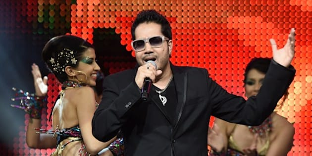 Bollywood singer Mika Singh performs on stage at the Mid Florida Credit Union Amphitheater during the IIFA Magic of the Movies show on the third day of the 15th International Indian Film Academy (IIFA) Awards in Tampa, Florida, April 25, 2014. AFP PHOTO JEWEL SAMAD        (Photo credit should read JEWEL SAMAD/AFP/Getty Images)