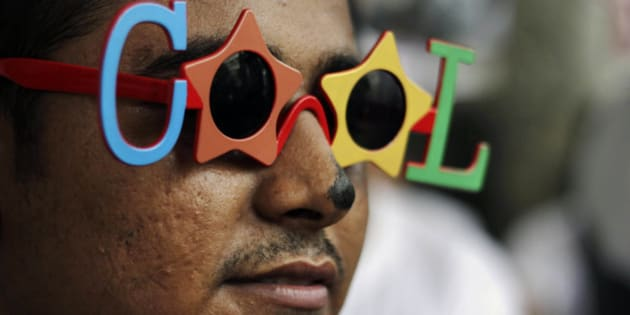 """An Indian activist of the lesbian, gay, bisexual, transgender (LGBT) rights movement wearing shades reading """"COOL"""" participates in a """"SlutWalk"""" in Kolkata, India, Friday, June 7, 2013. The event was held to protest any form of sexual harassment of any gender in public places among other issues. """"SlutWalk"""" protests originated in Toronto, Canada, where they were sparked by a police officer's remark that women could avoid being raped by not dressing like """"sluts."""" (AP Photo/Bikas Das)"""