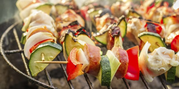 Hot skewers on the grill with fire.
