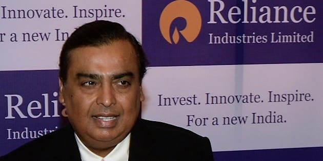 Reliance Industries chairman, Mukesh Ambani poses on his arrival for the company's annual general meeting in Mumbai on June 12, 2015.  Reliance Industries is holding its 41st annual general shareholders meeting.  AFP PHOTO/ PUNIT PARANJPE        (Photo credit should read PUNIT PARANJPE/AFP/Getty Images)