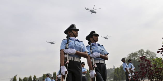 Helicopters fly over new graduates of the Indian Air Force during their passing out parade ceremony in Bangalore, India, Friday, Nov. 28, 2014. A total of 121 officers including 45 women completed Friday after 74 weeks of training at the primary force of the Indian Armed Forces. (AP Photo/Aijaz Rahi)