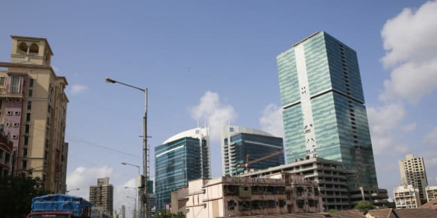 View of new and old buildings is seen at a neighborhood in Mumbai, India, Tuesday, June 2, 2015. India's central bank cut a key interest rate by a quarter percentage point Tuesday, the third such reduction this year in support of government efforts to boost growth. (AP Photo/Rafiq Maqbool)