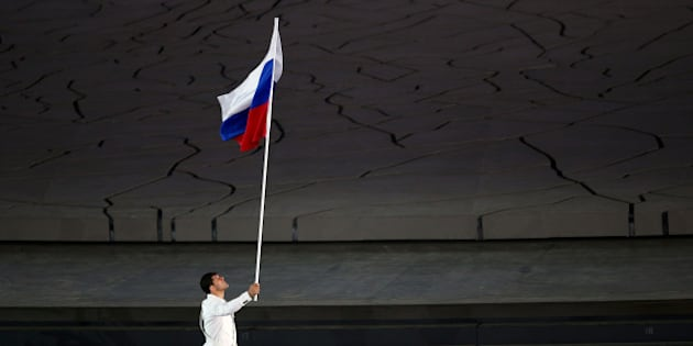 BAKU, AZERBAIJAN - JUNE 12:  flag bearer and wrestler, Khadzhimurat Gatcalov of Russia leads his team into the stadium during the Opening Ceremony for the Baku 2015 European Games at the Olympic Stadium on June 12, 2015 in Baku, Azerbaijan.  (Photo by Paul Gilham/Getty Images for BEGOC)