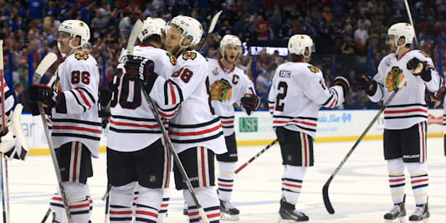 TAMPA, FL - JUNE 13:  Antoine Vermette #80 and Patrick Kane #88 of the Chicago Blackhawks celebrate after defeating the Tampa Bay Lightning by a score of 2-1 to win Game Five of the 2015 NHL Stanley Cup Final at Amalie Arena on June 13, 2015 in Tampa, Florida.  (Photo by Scott Iskowitz/Getty Images)