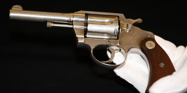 """A handgun once owned by notorious gangster """"Al"""" Capone, is displayed at Christie's auction house, London, Tuesday, June 21, 2011. The Colt .38 revolver will be going up for auction this week, and is expected to sell for between 50,000 pounds ($80,899/56,650 euro) and 70,000 pounds ($113,258/79,315 euro). (AP Photo/Tim Hales)"""