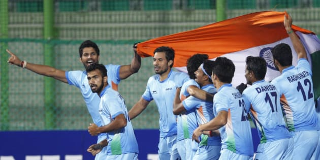 India's team celebrate after winning the men's gold medal hockey match against Pakistan at the 17th Asian Games in Incheon, South Korea, Thursday, Oct. 2, 2014.  (AP Photo/Kin Cheung)