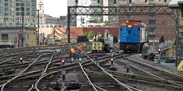 """Two workers do some work one of the double-slip or """"puzzle"""" switches, while their hi-railer (and trailer!) sits neraby.  Metra 178 had proceded out to the signal bridge, where the tower re-aligned the switches and signals so that it can back into station once again, on the track where it's train awaits.  Nice thing about track maintenace at the terminals...the trains are required to blow their horns to warn the maintenance people, otherwise you don't normally here the train horns in downtown Chicago.  Worth looking at in the LARGE size.   Saturday, July 12, 2008 Ogilvie Transportation Center Chicago, Illinois  Olympus E-510 DSLR  Olympus ED 40-150mm f4-5.6 zoom ISO 800 RAW"""