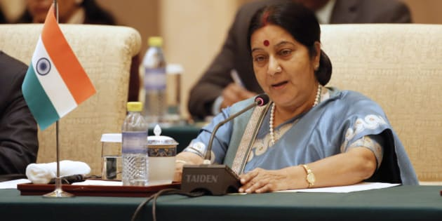 Indian Foreign Minister Sushma Swaraj speaks during the meeting of the Foreign Ministers of China, Russia and India at Diaoyutai State guesthouse in Beijing Monday, Feb. 2, 2015. (AP Photo/Wu Hong, Pool)