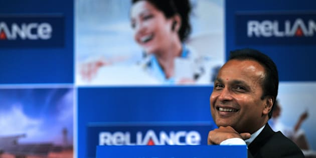 Indian industrialist and Chairman of  ADAG (Anil Dhirubhai Ambani  Group) Anil Ambani smiles during the annual general meeting of Reliance Power in Mumbai on September 4, 2012. Reliance Power, controlled by billionaire Anil Ambani, said that it started production at two coal mines in central India, ahead of schedule, which sent its shares up two percent. Coal from the Sasan mines will be used to generate electricity at the firm's 3,960-megawatt power project in the same region, a company statement said.  AFP PHOTO/ INDRANIL MUKHERJEE        (Photo credit should read INDRANIL MUKHERJEE/AFP/GettyImages)