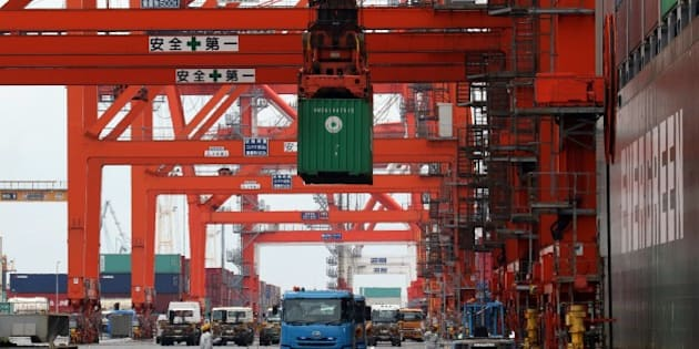 A container is loaded onto a flatbed truck from an international freighter at the international cargo terminal at Tokyo's port on May 25, 2015. Japan swung back to a trade deficit in April after the first surplus in almost three years in March, but the shortfall shrank drastically year-on-year thanks to stronger exports and lower energy bills, official data showed on May 25.       AFP PHOTO / Yoshikazu TSUNO        (Photo credit should read YOSHIKAZU TSUNO/AFP/Getty Images)