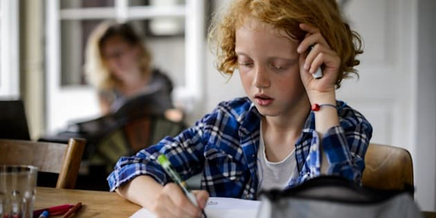 Swiss boy Leon, 9, does his homework on June 20, 2013 in his home in Moudon, western Switzerland.   AFP PHOTO / FABRICE COFFRINI RESTRICTED TO EDITORIAL USE        (Photo credit should read FABRICE COFFRINI/AFP/Getty Images)