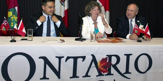 The commercial counselor of the Ontario government at the Canadian embassy in Mexico, Chantal Ramsay (C), XVII Pan-American games board member Victor Garcia (R), and press attache Fulvio Martinez, attend a press conference in Mexico City on May 25, 2015, to explain details about the next Toronto 2015 XVII Pan-American Games. AFP PHOTO/OMAR TORRES        (Photo credit should read OMAR TORRES/AFP/Getty Images)