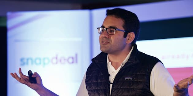 Co-Founder and CEO of Snapdeal Kunal Bahl gestures while addressing the media in Bangalore on April 8, 2015. India's largest online marketplace Snapdeal on April 8 announced that it has acquired 'FreeCharge' India's fastest growing mobile transactions platform, said to be one of the biggest acquisitions in the history of the Internet industry in India. AFP PHOTO/Manjunath KIRAN        (Photo credit should read MANJUNATH KIRAN/AFP/Getty Images)