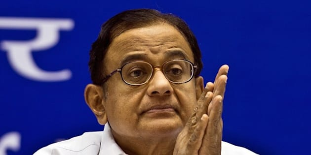 Indian Finance Minister P. Chidambaram listens to the speech given by Prime Minister Manmohan Singh during a conference on internal security in New Delhi on June 5, 2013.  The Prime Minister has convened an internal security meeting of Chief Ministers of all states to discuss the security issues at all fronts in the country.   AFP PHOTO/ Prakash SINGH        (Photo credit should read PRAKASH SINGH/AFP/Getty Images)