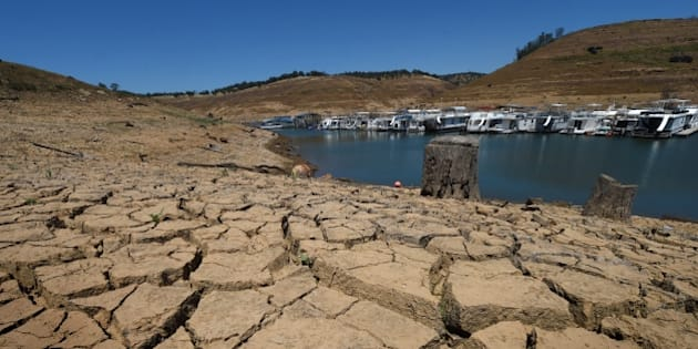 Dried mud and the remnants of a marina is seen at the New Melones Lake reservoir which is now at less than 20 percent capacity as a severe drought continues to affect California on May 24, 2015.  California has recently announced sweeping statewide water restrictions for the first time in history in order to combat the region's devastating drought, the worst since records began.          AFP PHOTO/ MARK RALSTON        (Photo credit should read MARK RALSTON/AFP/Getty Images)
