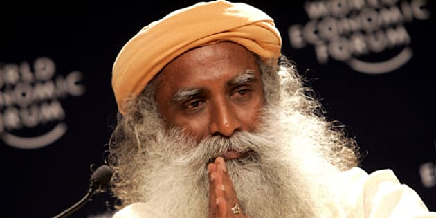 Founder of the Isha Foundation, India, Sadhguru Jaggi Vasudev gestures while speaking during a closing ceremony at the World Economic Forum in Davos, Switzerland, Sunday, Jan. 28, 2007. The closing ceremony explored the global challenges of this century and the recognition that at the center of these challenges every person has a part to play. (AP Photo/Virginia Mayo)
