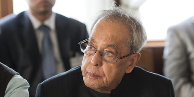 President of India Shri Pranab Mukherjee listens during a boat trip to Hammarby Sjoestad and roundtable discussion about 'Smart Cities' on June 1, 2015 in Stockholm on the second day of Shri Pranab Mukherjee's official three day visit in Sweden. AFP PHOTO / JONATHAN NACKSTRAND        (Photo credit should read JONATHAN NACKSTRAND/AFP/Getty Images)