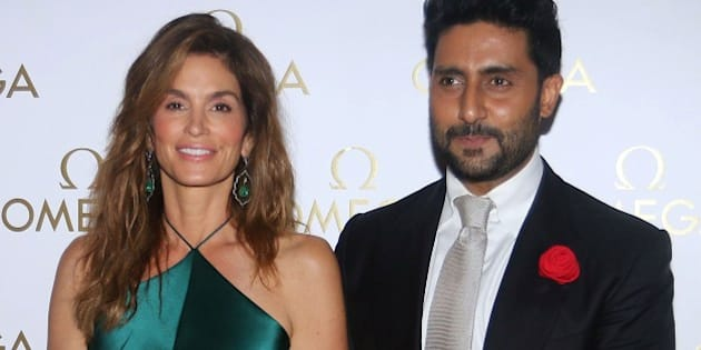 US model Cindy Crawford and Indian Bollywood actor Abhishek Bachchan pose as they arrive to attend a promotional event in Mumbai late June 18, 2015. AFP PHOTO/STR        (Photo credit should read STRDEL/AFP/Getty Images)