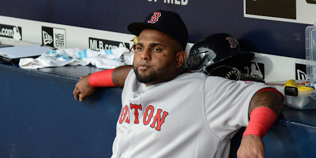 Boston Red Sox third baseman Pablo Sandoval (48) sits on the bench before the start of a baseball game against the Atlanta Braves Thursday, June 18, 2015, in Atlanta. Boston third baseman Pablo Sandoval has been benched by manager John Farrell after using his Instagram account during a loss to the Braves on Wednesday. (AP Photo/Jon Barash)