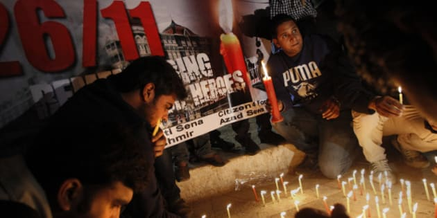 Indians participate in a candle light vigil in memory of those who lost their lives in the 2008 Mumbai terror attacks on its anniversary in New Delhi, India, Monday, Nov. 26, 2012. India Wednesday executed the lone surviving gunmen from the 2008 Mumbai terror attack, four years after Pakistani gunmen blazed through India's financial capital, killing 166 people and shattering relations between the nuclear-armed neighbors. (AP Photo/Tsering Topgyal)
