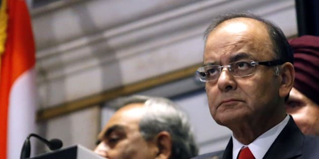 India's Finance Minister Arun Jaitley looks on before he rings the closing bell for the trading session at the New York Stock Exchange in New York on June 17, 2015. Wall Street stocks rose early ahead of a Federal Reserve policy statement that could offer clues on when the US central bank will begin lifting interest rates. AFP PHOTO/ KENA BENTACUR        (Photo credit should read KENA BETANCUR/AFP/Getty Images)