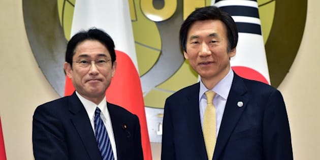 South Korean Foreign Minister Yun Byung-Se (R) shakes hands with his Japanese counterpart Fumio Kishida (L) during their meeting at the foreign ministry in Seoul on March 21, 2015. The foreign ministers of South Korea, Japan and China gathered in Seoul for their first meeting in nearly three years, aimed at calming regional tensions rooted in territorial and other diplomatic disputes. AFP PHOTO / POOL / JUNG YEON-JE        (Photo credit should read JUNG YEON-JE/AFP/Getty Images)
