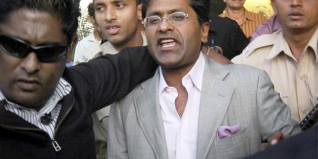 Indian Premier League (IPL) Chairman Lalit Modi arrives at the airport in Mumbai, India, Tuesday, April 20, 2010. Top cricket officials hope to resolve next week the crisis facing the IPL, including the future of Modi, beleaguered by allegations of corruption in an auction to add a new team to the lucrative tournament. (AP Photo) **INDIA OUT **
