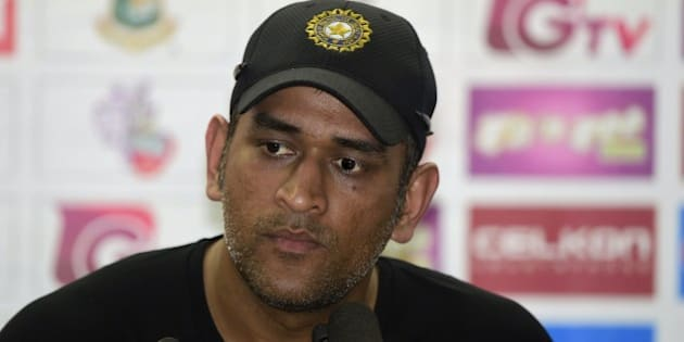 Indian cricket captain  Mahendra Singh Dhoni speaks with the press after a practice session at the Sher-e-Bangla National Cricket Stadium in Dhaka on June 17, 2015, ahead of the first ODI (One Day International) cricke match against Bangladesh. AFP PHOTO/Munir uz ZAMAN        (Photo credit should read MUNIR UZ ZAMAN/AFP/Getty Images)