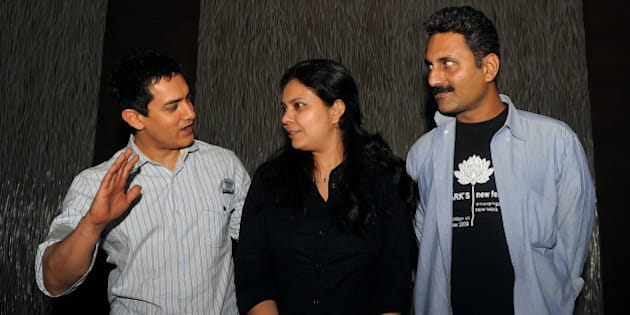 Indian Bollywood Actor Aamir Khan (L), writer and directors Anusha Rizvi (C) and Mahmood Farooqui (R) attend a promotional event for the new film' Peepli Live', in New Delhi on July 7, 2010. Khan produced the Bollywood film 'Peepli Live', written and directed by Anusha Rizvi and is scheduled to be relased on August 13. AFP PHOTO/Manan Vatsyayana (Photo credit should read MANAN VATSYAYANA/AFP/Getty Images)