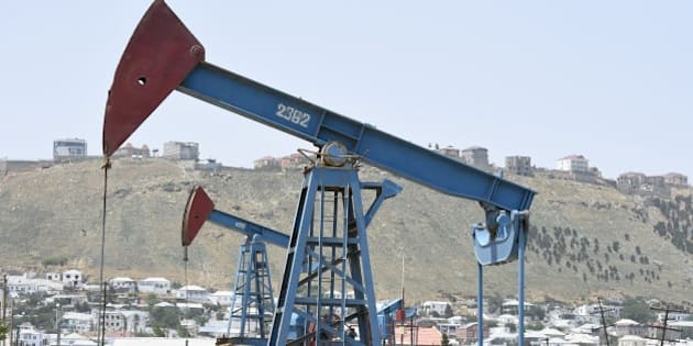 Oil pumps are pictured in an oil field on June 16, 2015 in Baku, Azerbaijan. AFP PHOTO / TOBIAS SCHWARZ        (Photo credit should read TOBIAS SCHWARZ/AFP/Getty Images)