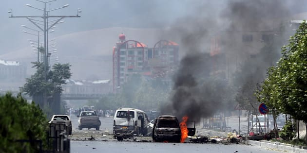 Fire and smokes rise at the site of a suicide attack during clashes with Taliban fighters in front of the Parliament, in Kabul, Afghanistan, Monday, June 22, 2015. The Taliban launched a complex attack on the Afghan parliament Monday, with a suicide car bomber striking at the entrance and gunmen battling police as lawmakers were meeting inside to confirm the appointment of a defense minister, police and witnesses said. (AP Photo/Massoud Hossaini)