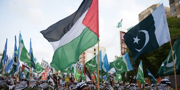 Pakistan activists from the Jamaat-e-Islami party carry flags as they march during a pro-Palestinian demonstration against Israel's military campaign in Gaza, in Karachi on August 17, 2014. Indirect talks between Israelis and Palestinians for a long-term truce in Gaza resumed on August 17, 2014, with just over a day left before a temporary ceasefire is set to expire, a Palestinian official said. AFP PHOTO/Rizwan TABASSUM        (Photo credit should read RIZWAN TABASSUM/AFP/Getty Images)