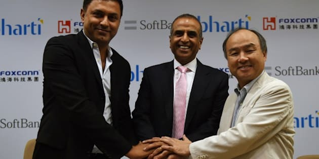 Chairman of Bharti Enterprises Sunil Bharti Mittal (C), CEO of SoftBank Masayoshi Son (R) and Chairman of SoftBank Corp Nikesh Arora (L) shake hands before the start of a press conference in New Delhi on June 22, 2015. Japan's SoftBank will team up with Taiwan's Foxconn and India's Bharti Enterprises to invest $20 billion in solar power projects in India, as the country ramps up its clean energy sector, the companies announced. AFP PHOTO/MONEY SHARMA        (Photo credit should read MONEY SHARMA/AFP/Getty Images)