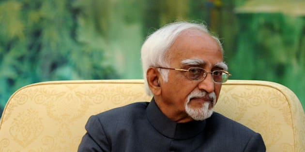BEIJING, CHINA - JUNE 30: Indian Vice President Shri Mohammad Hamid Ansari talks as he meets with Chinese President Xi Jinping (not in picture) at the Great Hall of the People on June 30, 2014 in Beijing, China.  Shri Mohammad Hamid Ansari is on a visit to China from June 26 - 30.  (Photo by Wang Zhao - Pool / Getty Images)