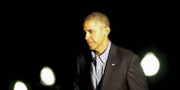 WASHINGTON ,DC - JUNE 21: (AFP OUT) U.S. President Barack Obama returns to the White House June 21 2015, in Washington, DC. Obama is returning from a trip to Los Angeles and San Francisco, attending DNC events and speaking at the annual U.S. Conference of Mayors in San Francisco. (Photo by Aude Guerrucci-Pool/Getty Images)