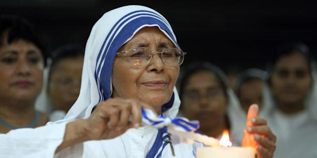 Sister Nirmala, successor to Mother Teresa, lights a candle as he is joined by fellow nuns and volunteers of the Missionaries of Charity to celebrate the 97th birth anniversary of Mother Teresa at the Mother House at the Missionaries of Charity in Kolkata, 26 August 2007. Hundreds of nuns of the house with a number of volunteers took part in the morning service to mark the day.  Mother Teresa was born 26 August, 1910 in what is now Skopje, Macedonia.       AFP PHOTO/Deshakalyan CHOWDHURY (Photo credit should read DESHAKALYAN CHOWDHURY/AFP/Getty Images)