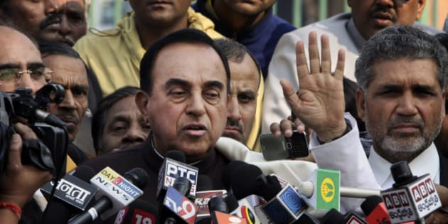 India's opposition lawmaker Subramanian Swamy speaks to the media outside the Supreme Court in New Delhi, India, Thursday, Feb. 2, 2012. India's top court ordered the government on Thursday to cancel 122 cellphone licenses granted to companies during an irregular sale of spectrum that has been branded one of the largest scandals in India's history. Swami filed the court complaint based on which the court canceled the licenses. (AP Photo)