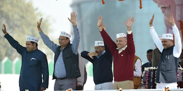 Aam Aadmi Party (AAP) president Arvind Kejriwal (C) and fellow AAP ministers  Asim Ahmed Khan (L), Satyendra Jain (2L), Manish Sisodia (2R) and Jitender Singh Tomar greet supporters during his swearing-in ceremony as Delhi chief minister in New Delhi on February 14, 2015.  Arvind Kejriwal promised to make Delhi India's first corruption-free state and end what he called its 'VIP culture' as he was sworn in as chief minister before a huge crowd of cheering supporters .   AFP PHOTO / PRAKASH SINGH        (Photo credit should read PRAKASH SINGH/AFP/Getty Images)