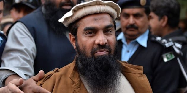 Pakistani security personnel escort Zaki-ur-Rehman Lakhvi (C), alleged mastermind of the 2008 Mumbai attacks, leaves the court after a hearing in Islamabad on January 1, 2015. Pakistan on January 1, approached the country's supreme court to stop the release of alleged mastermind of the 2008 Mumbai attacks whose detention order was this week suspended by a high court, a government prosecutor said. AFP PHOTO/ Aamir QURESHI        (Photo credit should read AAMIR QURESHI/AFP/Getty Images)