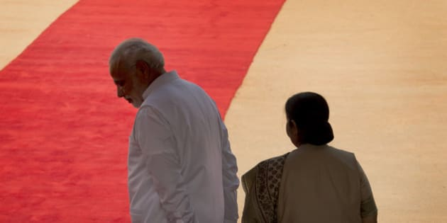 Indian Prime Minister Narendra Modi, left, and Foreign Minister Sushma Swaraj wait for the arrival of Tanzanian President Jakaya Kikwete at the Indian presidential palace in New Delhi, India, Friday, June 19, 2015. Opposition parties in India are demanding the resignation of Swaraj over her decision to help a controversial Indian cricket official and businessman Lalit Modi living in the UK, according to local news agency Press trust of India. (AP Photo/Manish Swarup)
