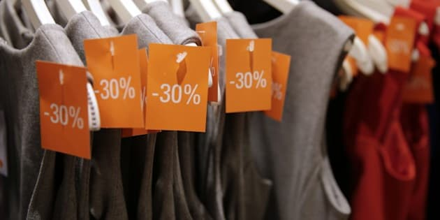 Clothes are on display with  reduced prices in a French department store, at the start of the summer sales, on June 24, 2015 in Paris. Sales in France run until August 4.     AFP PHOTO / KENZO TRIBOUILLARD        (Photo credit should read KENZO TRIBOUILLARD/AFP/Getty Images)