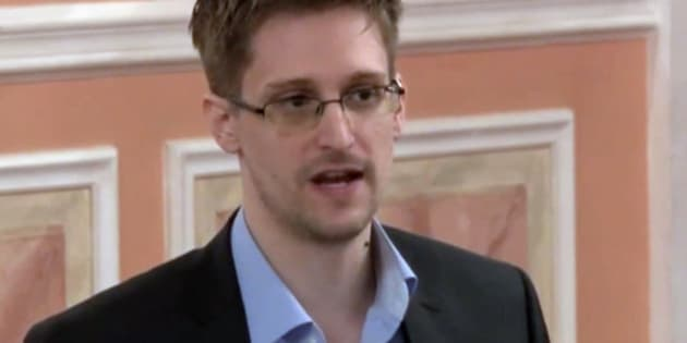 FILE - In this file image made from video released by WikiLeaks on Friday, Oct. 11, 2013, former National Security Agency systems analyst Edward Snowden speaks during a presentation ceremony for the Sam Adams Award in Moscow, Russia. Snowden was awarded the Sam Adams Award, according to videos released by the organization WikiLeaks. The award ceremony was attended by three previous recipients. (AP Photo, File)