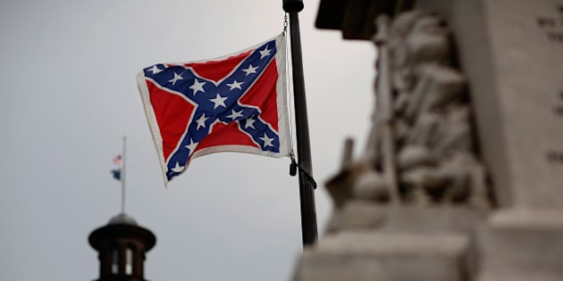 COLUMBIA, SC - JUNE 23:  The Confederate flag flies on the Capitol grounds one day after South Carolina Gov. Nikki Haley announced that she will call for the Confederate flag to be removed on June 23, 2015 in Columbia, South Carolina. Debate over the flag flying at the Capitol was again ignited off after nine people were shot and killed during a prayer meeting at the Emanuel African Methodist Episcopal Church in Charleston, South Carolina.  (Photo by Win McNamee/Getty Images)