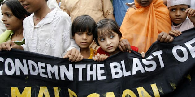 Kolkata, INDIA:  Indian Muslim children shout slogans as they march with a banner during a protest rally in Kolkata, 09 September 2006, a day after bomb blasts killed 31 people in the western Indian town of Malegaon. Relatives buried their dead after three bombs outside a mosque and graveyard targeted Muslim worshippers leaving the mosque in the town, the scene of previous clashes between Hindus and Muslims.  AFP PHOTO/Deshakalyan CHOWDHURY  (Photo credit should read DESHAKALYAN CHOWDHURY/AFP/Getty Images)