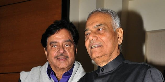 Indian Bollywood actor and politician Shatrughan Sinha (L) and politician and former finance minister Yashwant Sinha, who was conferred the Officer of the Legion of Honour in New Delhi earlier in the week, attend an event in Yashwant Sinha's honour in Mumbai late on June 23, 2015.    AFP PHOTO        (Photo credit should read STR/AFP/Getty Images)